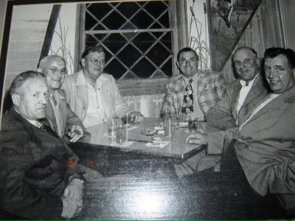 George, while living, to the far left, along with friends