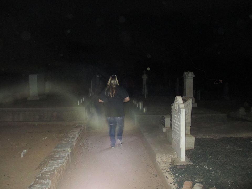 Michelle Le Baron encircled by spirit energy in the Ione Cemetery. Ione, California. (Photo Credit: Leslie Rae Sinks)