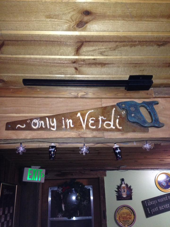 A decorated saw hanging in the local Verdi Grill & Pizzeria.