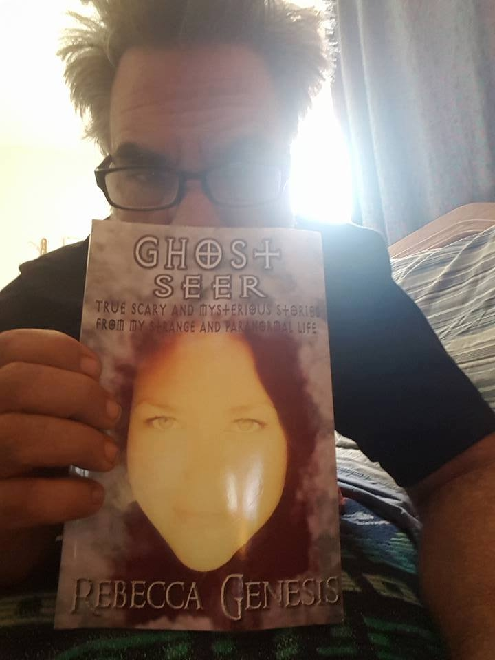 Scott Gruenwald with a copy of my book, Ghost Seer.