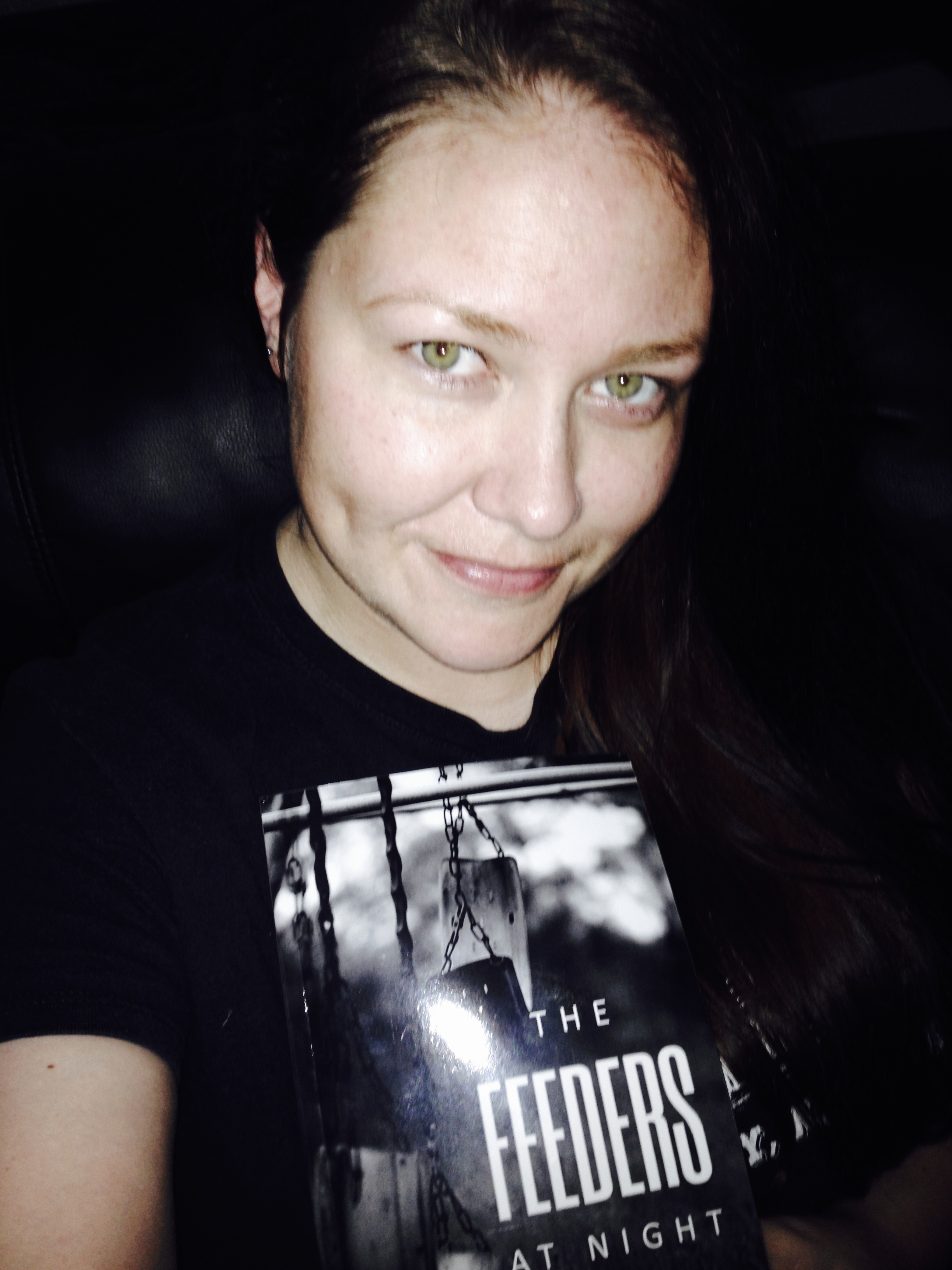 The Author, Rebecca Genesis, and the possible haunted book, The Feeders at Night